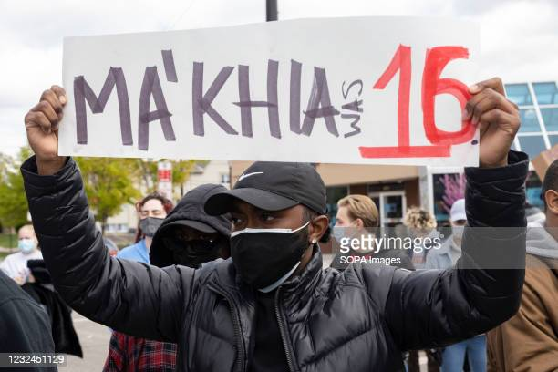 Black Lives Matter activist holds a placard protesting the police killing of MaKhia Bryant during the demonstration. Ohio State University Students...