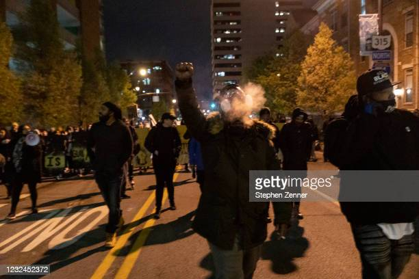 Black Lives Matter activist raises fist during a protest in reaction to the police shooting of MaKhia Bryant, on April 21, 2021 in Columbus, Ohio....