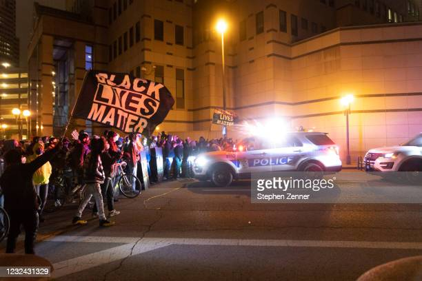 Black Lives Matter activists confront Columbus Police outside of Columbus Police headquarters during a protest in reaction to the shooting of Makiyah...