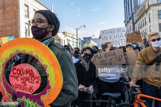 Black Lives Matter activists fill the intersection of High St. And Bollinger Pl., blocking it off with bikes and shields during a protest against the...