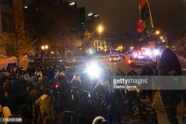 Black Lives Matter activists form a line across from a line of police to protest the police shooting of Makiyah Bryant on April 20, 2021 in Columbus,...