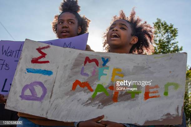 Black Lives Matter activists hold placards advocating for their lives to matter at a protest against the police killing of Ma'Khia Bryant. Black...