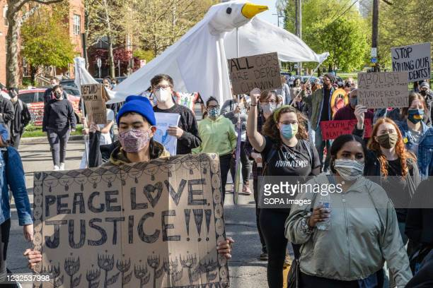 Black Lives Matter activists hold placards and a large effigy of a dove to commemorate Ma'Khia Bryant and protest her death. Black Lives Matter...