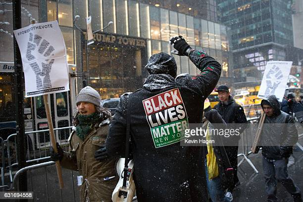 Black Lives Matter activists march in front of Trump Tower on January 14 2017 in New York City