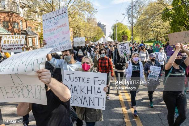 Black Lives Matter activists march through the streets of Columbus while holding placards expressing their opinion at a protest against the police...