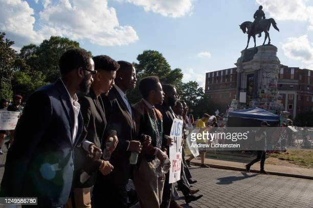 Black Lives Matter activists occupy the traffic circle underneath the statue of Confederate General Robert Lee now covered in graffiti on June 13...