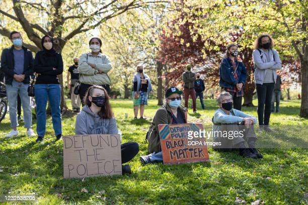 Black Lives Matter activists sit and stand a protest in Goodale Park against the police killing of Ma'Khia Bryant. Black Lives Matter activists...