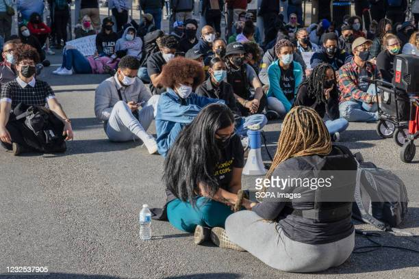 Black Lives Matter activists sit in silence for 16 minutes to commemoration Ma'Khia Bryant, who was 16 when she was shot and killed by the police....