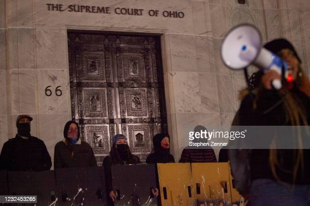 Black Lives Matter activists stand outside of The Supreme Court of Ohio, and denounce the hypocrisy of the judicial system during a protest reacting...