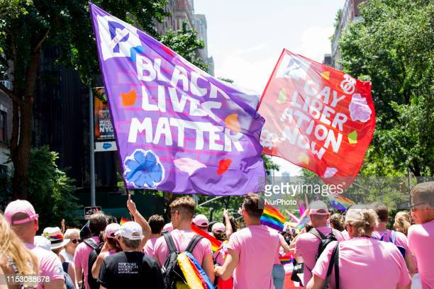 Black Lives Matter and Gay Liberation flags are waved at the annual Pride Parade on Sunday, June 29, 2019 in New York, NY. This years annual Pride...