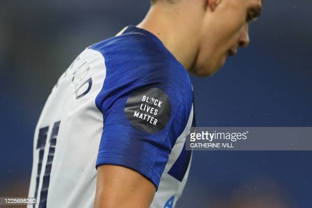 Black Lives Matter' badge is worn on a sleeve during the English Premier League football match between Brighton and Hove Albion and Liverpool at the...