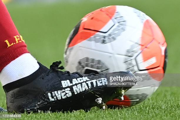 Black Lives Matter is seen on the boot of Liverpool's English defender Trent AlexanderArnold during the English Premier League football match between...