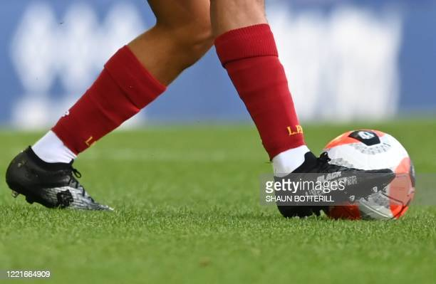 Black Lives Matter is seen written on the boot of Liverpool's English defender Trent Alexander-Arnold during the English Premier League football...