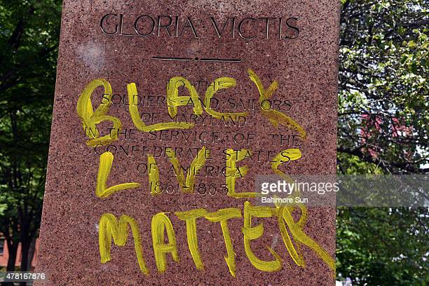 """""""Black Lives Matter"""" is written in yellow on the base of the Confederate Soldiers and Sailors Monument on Mount Royal Avenue on June 22, 2015 in..."""