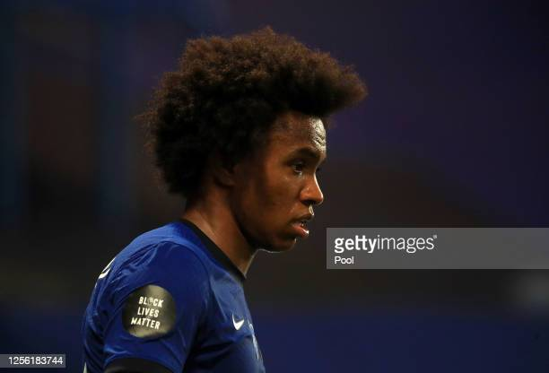Black Lives Matter movement logo is seen on the shirt sleeve of Willian of Chelsea during the Premier League match between Chelsea FC and Norwich...