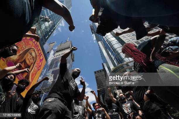 Black Lives Matter New York cofounder Hawk Newsome leads protesters during a demonstration in Times Square over the death of George Floyd by a...