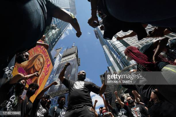 TOPSHOT Black Lives Matter New York cofounder Hawk Newsome leads protesters during a demonstration in Times Square over the death of George Floyd by...