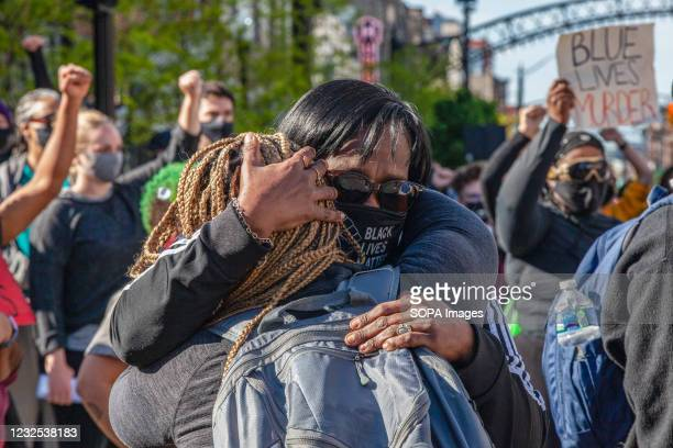 Black Lives Matter organizers comfort one another at a protest against the police killing of Ma'Khia Bryant at the intersection of High St. And...