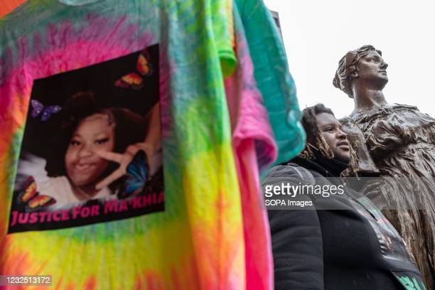 Black Lives Matter paraphernalia features MaKhia Bryants photo on a shirt. Black Lives Matter activists gathered in front of the Columbus Police...