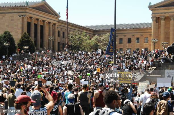 Black Lives Matter Philly Real Justice and thousands of Philadelphians rallied on the steps of the Philadelphia Art Museum before defending on Center...