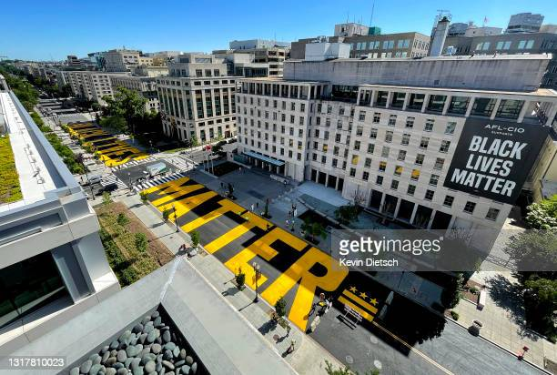 Black Lives Matter Plaza on 16th Street is repainted following the removal of the lettering for a construction project on May 13, 2021 in Washington,...