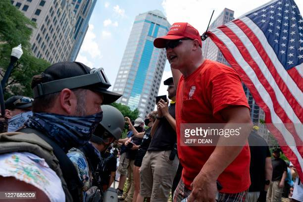 "Black Lives Matter protertors confront anti-mask groups in front of the Ohio Statehouse during a right-wing protest ""Stand For America Against..."