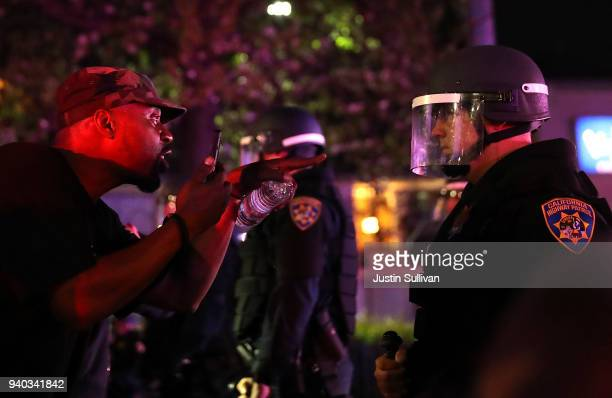 Black Lives Matter protester confronts a California Highway Patrol officer during a demonstration on March 30 2018 in Sacramento California Hundreds...