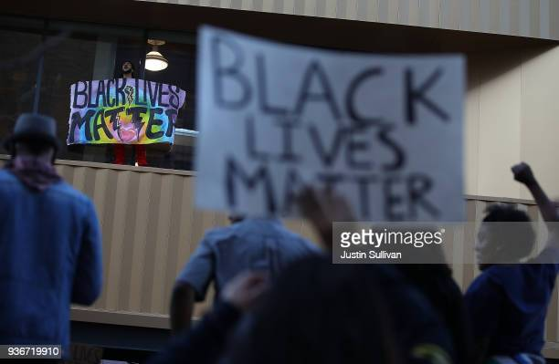Black Lives Matter protester holds a sign during a demonstration on March 22 2018 in Sacramento California Hundreds of protesters staged a...