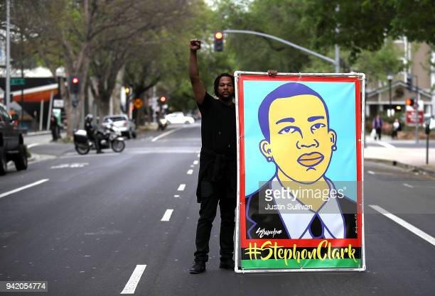 Black Lives Matter protester holds an illustration of Stephon Clark during a march and demonstration through the streets of Sacramento on April 4...