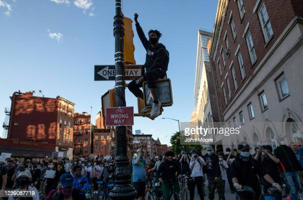 Black Lives Matter protester raises his fist during a march to honor George Floyd in Manhattan on May 31 2020 in New York City Protesters...