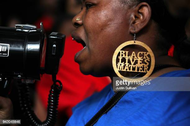 Black Lives Matter protester uses a bullhorn during a demonstration in front of the offices of Sacramento district attorney Anne Marie Schubert on...
