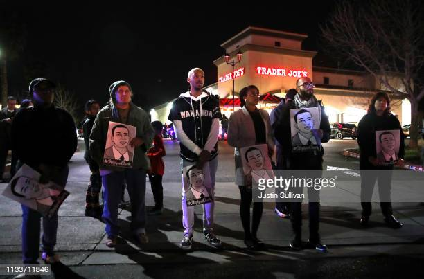 Black Lives Matter protesters block an entrance to a Trader Joe's store as they demonstrate the decision by Sacramento District Attorney to not...