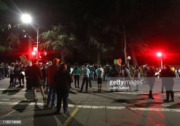 Black Lives Matter protesters block an intersection as they march through the streets to demonstrate the decision by Sacramento District Attorney to...