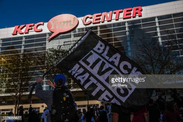Black Lives Matter protesters gather on the pavilion in front of the KFC YUM! Center for early voting on October 13, 2020 in Louisville, Kentucky....