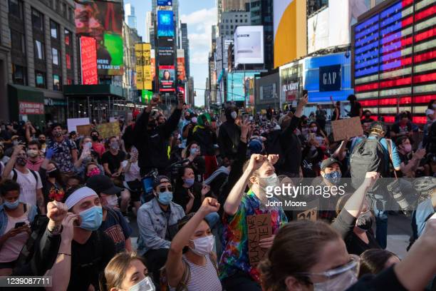 Black Lives Matter protesters kneel in Times Square while marching to honor George Floyd in Midtown Manhattan on May 31 2020 in New York City...