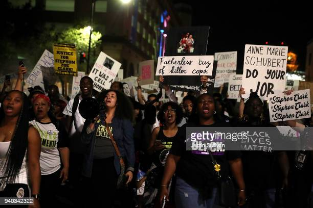 Black Lives Matter protesters march through the streets of Sacramento during a demonstration on March 30 2018 in Sacramento California Hundreds of...