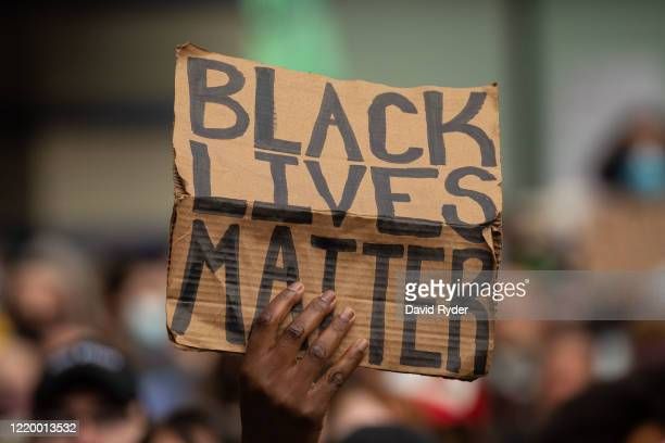 Black Lives Matter protesters rally at Westlake Park before marching through the downtown area on June 14 2020 in Seattle United States Black Lives...