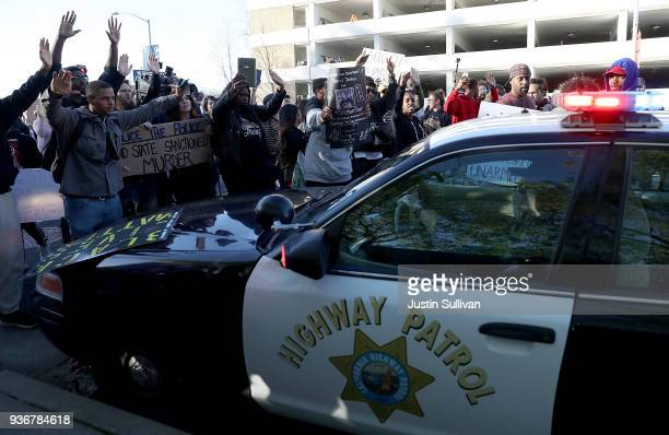 Black Lives Matter protesters surround a California Highway Patrol car as it attempts to drive down a street during a demonstration on March 22 2018...