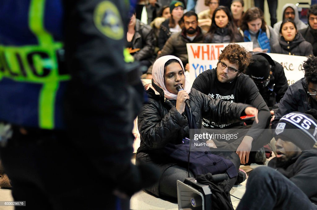 Black Lives Matter protestors hold a sit in and block an exit as thousands turn out for a January 29th, 2017 Immigration Ban Protest at Philadelphia International Airport, in Philadelphia Pennsylvania.