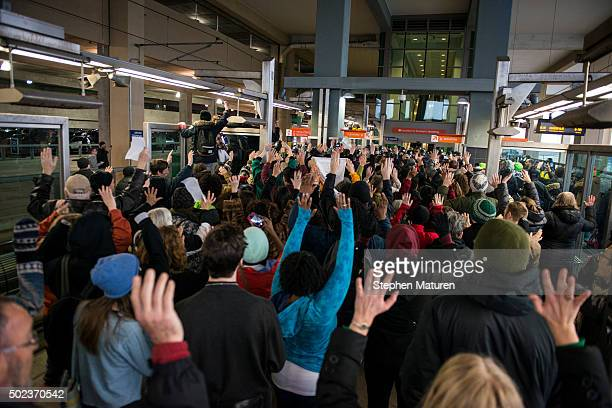Black Lives Matter protestors hold their hands in the air and chant 'Hands up don't shoot' at the MinneapolisSt Paul International airport Lightrail...