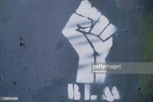 Black Lives Matter raised fist logo on 26th November 2020 in Birmingham, United Kingdom. Black Lives Matter is an international human rights...