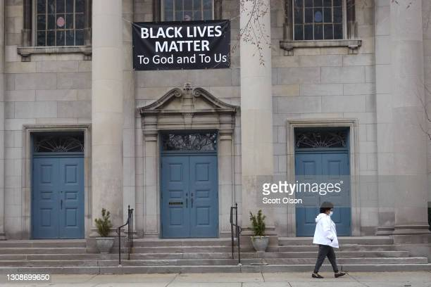 Black Lives Matter sign hangs in front of the First Congregational Church of Evanston UCC on March 23, 2021 in Evanston, Illinois. The City Council...