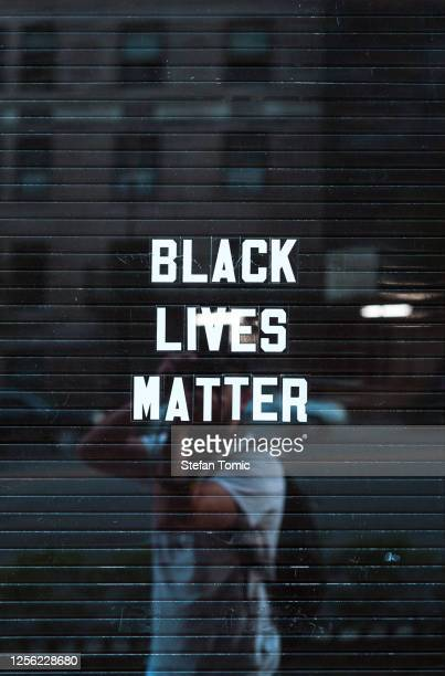 black lives matter sign in downtown manhattan new york reflecting background - anti racism stock pictures, royalty-free photos & images