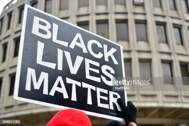 Black Lives Matter sign is held by a protestor participating as community members join religious leaders and clergymen with Philadelphians Organized...