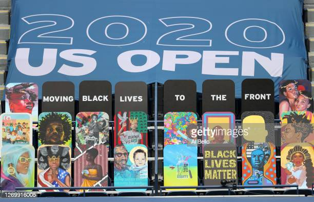 """Black Lives Matter"""" signage is seen front row in Arthur Ashe Stadium on Day One of the 2020 US Open at the USTA Billie Jean King National Tennis..."""