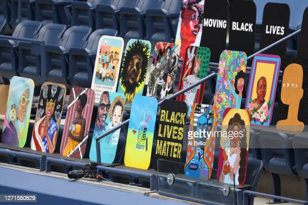 """Black Lives Matter"""" signage is seen in the front row of Arthur Ashe stadium as Serena Williams of the United States plays Tsvetana Pironkova of..."""