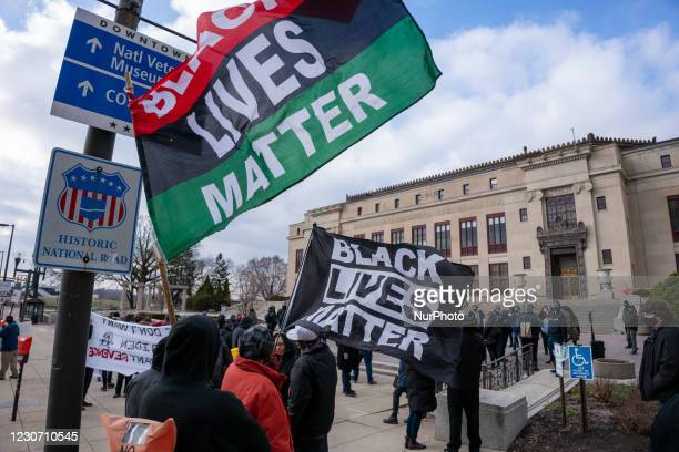 Black Lives Matter signs are hoisted in the air as members of Antifa march from City Hall to the Ohio Statehouse after President Joe Biden was sworn...