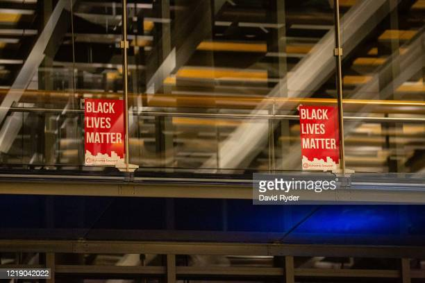 Black Lives Matter signs are seen inside Seattle City Hall after demonstrators marched inside led by Seattle City Council member Kshama Sawant on...