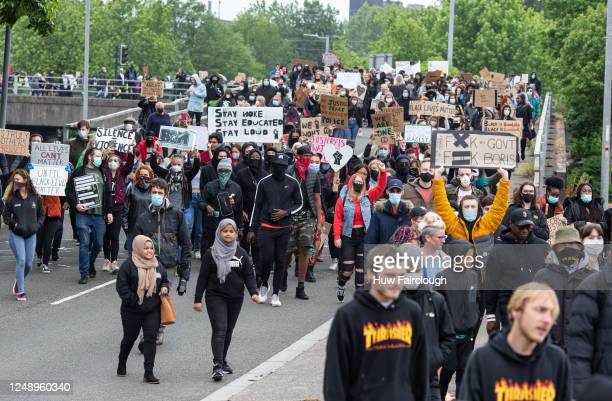 Black Lives Matter supporters carry placards as they march from Newport Civic Centre to Newport University on June 11 2020 in Newport Wales United...