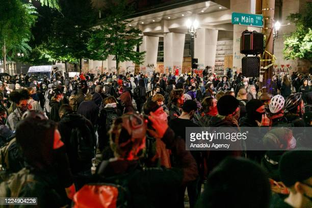 Black Lives Matter supporters demonstrate in Portland, Oregon on July 4, 2020 for the thirty-eighth day in a row at Portland's Justice Center and...